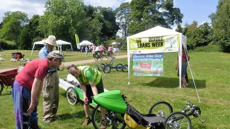 A member of Transition St Albans explaining the workings of one of the electric bikes. Picture: Pete