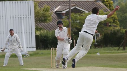 Ed Wharton bounces one back to the bowler. Picture: Danny Loo