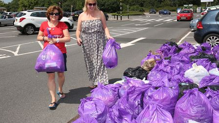 Slimming world consultant Lesley Thornalley-Grey accepts some donations from a Slimming World member