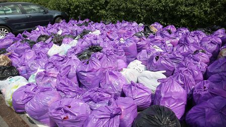 Some of the bags of clothes collected by Slimming World for Cancer Research. Picture: Danny Loo