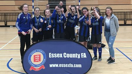 The St Ives Rangers Girls team celebrate their success at the Regional Futsal Finals.
