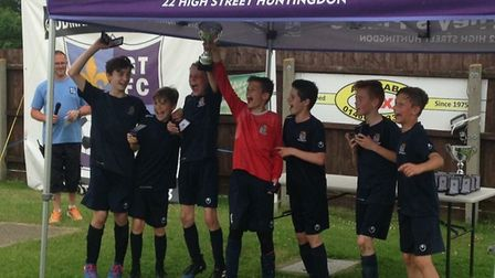 St Neots Town Sky Under 12 celebrate their success at the Godmanchester Town tournament.