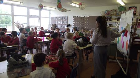 Meridian School art teacher Miss Phelps leading a session with pupils from St Mary's Catholic Primar