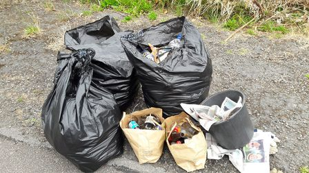 Bags of rubbish collected by the campaigners and Councillor Jarvis with Ruth Brown and Carol Stanier