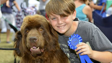 Charlie O'Reilly, 11, with his Newfoundland Ruby.