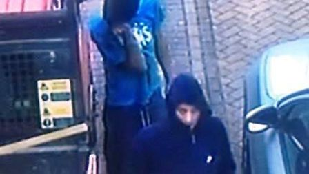 CCTV images of two men police would like to speak to in connection with a burglary in Hilton