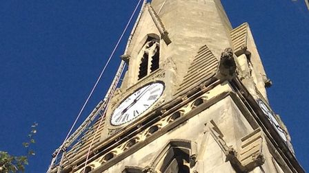 Steeplejacks have erected ladders on the Free Church spire, in St Ives.