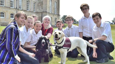 Hearing dogs Rosie and Orion with Hearing Dogs for Deaf People volunteer Deborah Maloney, and pupils
