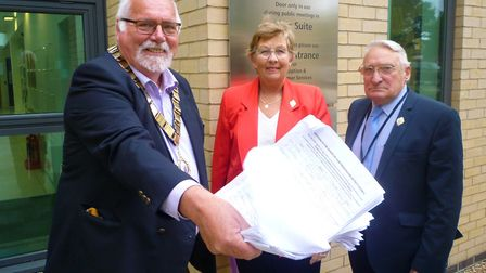 Derek Giles, Sandie Giles and James Corley with the petition.