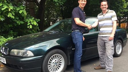 Martin Robson, left, and his BMW prepare for the St Albans to Bangor challenge. Picture: RENNIE GROV