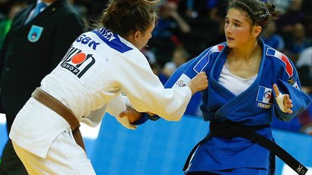 Amy Platten fights Liza Gateau of France at the Cadet European Championships.
