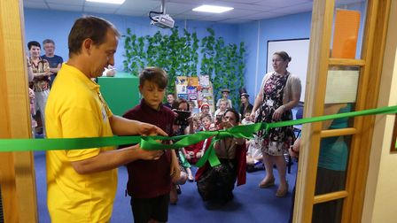 Author and illustrator Stephen Meakin officially opens Somersham Primary Schools new library with So
