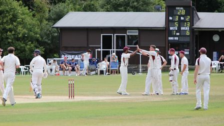 Harpenden celebrate getting the wicket of Potters Bar's Harrison Palmer.Picture: MELISSA PAGE