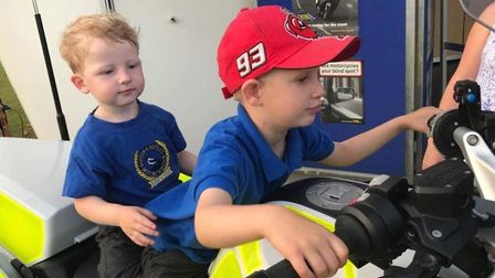 Daniel Coningsby, two, and five-year-old big brother Matthew try out one of the bikes. Picture: Mark