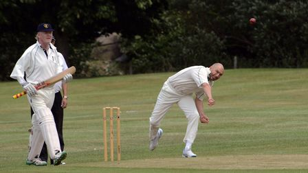 Houghton & Wyton bowler Jerry Wood sends down a delivery in their Hunts League success at Alconbury.