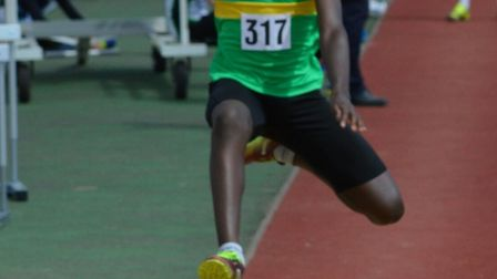Apo Opaleye competing in the long jump at the Eastern Counties Championships.