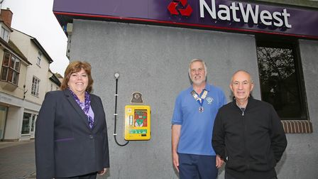 NatWest manager Penny Bullock, Royston Lions president Keith Collard and retired paramedic duty offi