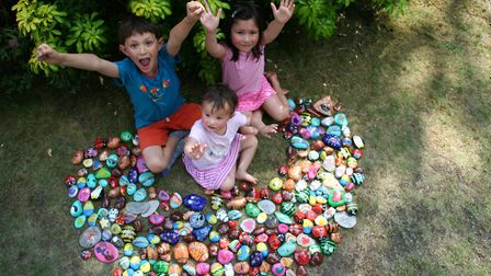 Harry, Ella and Phoebe with the launch rocks. Photo: JOHN AND NICOLA WONG