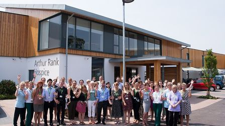 Some of the hospice's 200+ members of staff gathered at the front of their purpose-built facility a