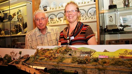 Derek Burrows with his 00 gauge display and museum assistant, Amy Judd. Picture: Clive Porter