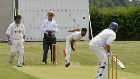 Jhanzaib Khan sends down a delivery for Huntingdon & District in their win at Warboys. Picture: DUNC