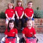 Children at Little Robins Pre-School in St Albans with the two new defibrillators. Picture: LITTLE R