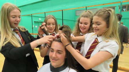 Connor's fellow students helped out with his head shaving.