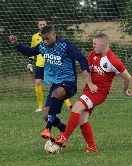 Godmanchester Rovers and Brampton players battle for the ball in Saturday's friendly.