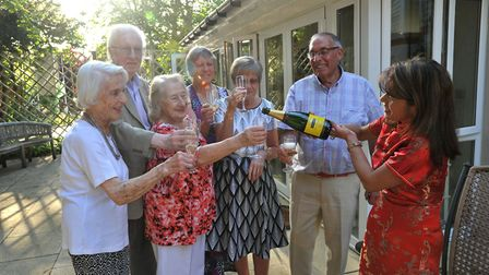 Constance Place residents celebrated their home's first anniversary with house manager Virginia Garv