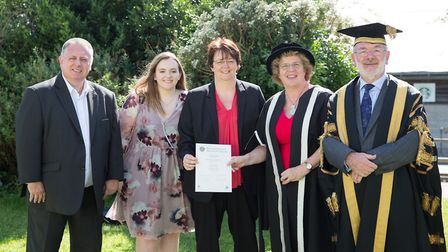 Pictured left to right are Emily's father John, sister Katie and mother Natasha with Vice-Chancellor