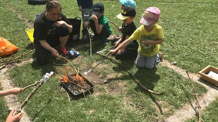 Children toasting marshmallows with Alix Marschani. Picture: Courtesy of Therfield First School