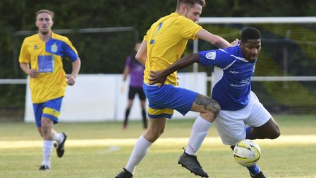 Shaun Lucien looks to get away from Connor Arnold. Picture: BOB WALKLEY