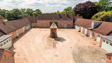 The courtyard includes a staff cottage, two flats, garages, stables and other outbuildings