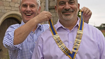 Chris Shannon hands over the chain of office to Nick Abell