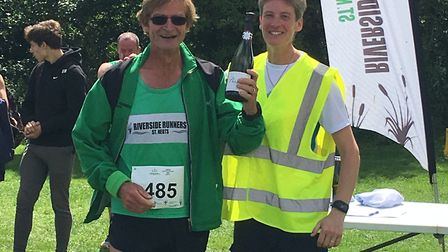 Maurice Hemmingway (left) toasts his M60 success at the Riverside 10k.