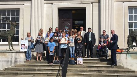 The families of Nascot Lawn presenting their petition to Herts county council in Hertford. Photo: FR