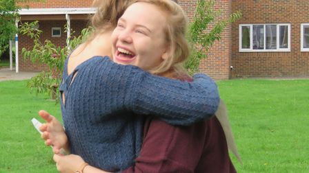 Francesca Churchill gets a hug after doing well in her GCSE results.