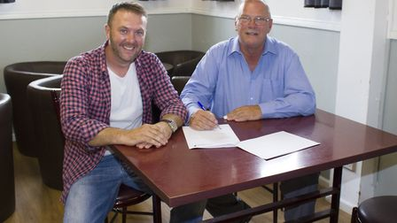 Gary Clarke, St Ives Town chairman, with James Sculthorpe, from ProEdge.
