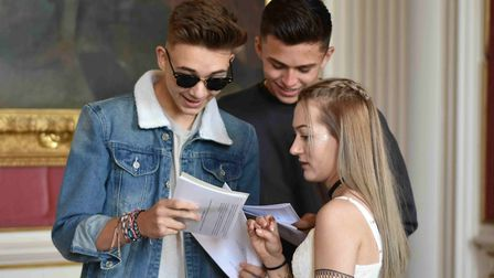 Kimboltn School student Lucas Gross opening his results with Joe Dobos and Hollie Cowie