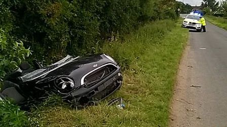 Emergency services attended the scene of a collision in Somersham in which a car had landed in a dit