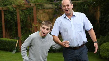 David Josephs with his son Dominic in the garden of their home. Picture: Danny Loo