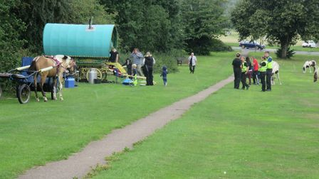Travellers, with caravans and horses, speaking to police. Photo: STEVE GLEDHILL