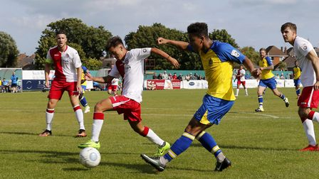 St Albans Zane Banton drills the ball across the Poole area (pic Leigh Page)