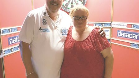Martin Adams with Michelle Castle at the charity darts night