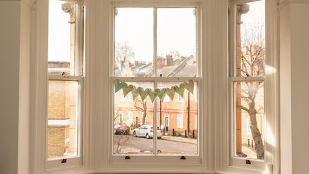 Fitting a curtain pole to a bay window can seem difficult, but there are DIY solutions [PA Photo/thi