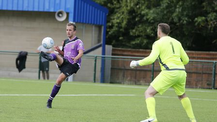 Sam Merson tries to lift the ball over Craig Hill. Picture: LEIGH PAGE