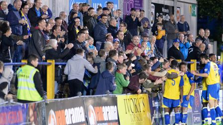 Saints players celebrate with the fans after scoring against Wealdstone. Picture: BOB WALKLEY