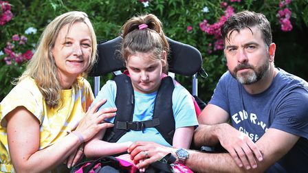 Claire and Chris Bryson with their daughter Evelyn, 9. Picture: Danny Loo