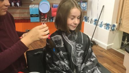 Olive Anderson Beaman having her hair cut by Kelly.