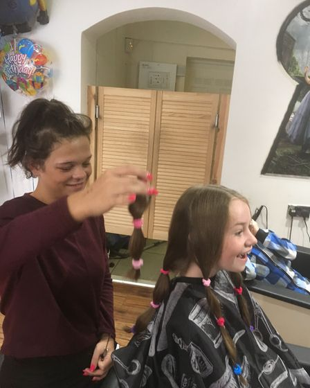 Olive having her hair cut by Kelly.